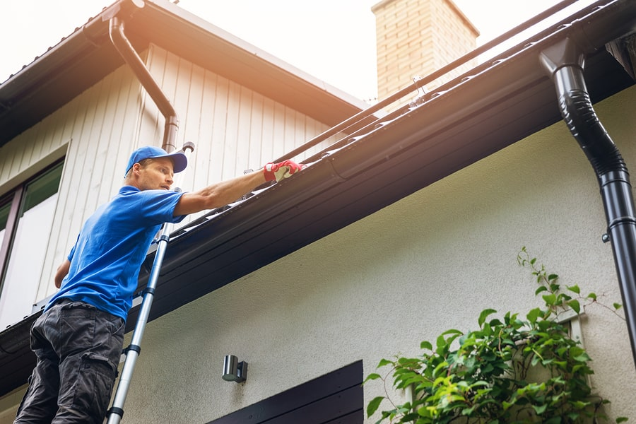 Man Attending To Gutters